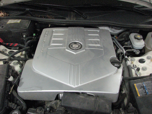 how to add transmission fluid to a 2005 cadillac cts